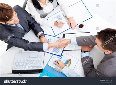 13921 business meeting handshake business handshake businessmen shake stock