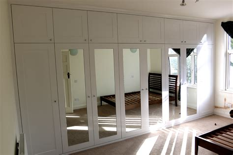 Bespoke Cabinets London wardrobe company floating shelves boockcase cupboards