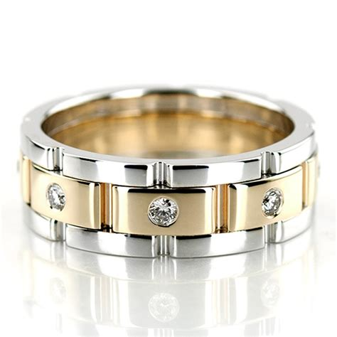 this rolex style diamond wedding band has shaped diamonds with a burnish setting find this