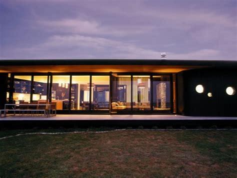 single story  wings house  dark cedar cladding