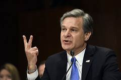 wray says Russians helping Trump in election