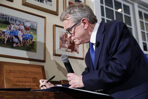 ohio governor mike dewine sworn   home signs