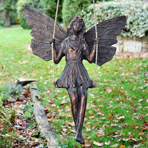 large bronze effect on a swing garden sculpture