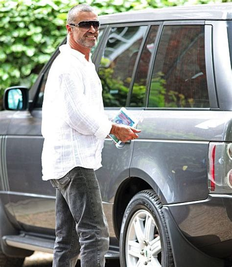 george michael crashes range rover  photo shop