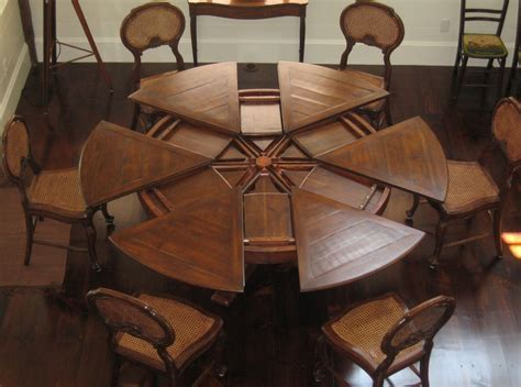 Round tables with self storing leaves for the dining room