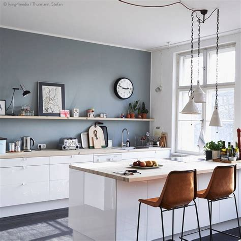 kitchen wall color ideas grey wall with white cabinets and warm brown chairs crisp