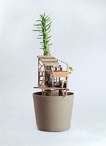 Miniature Treehouse Sculptures Built Around Houseplants by