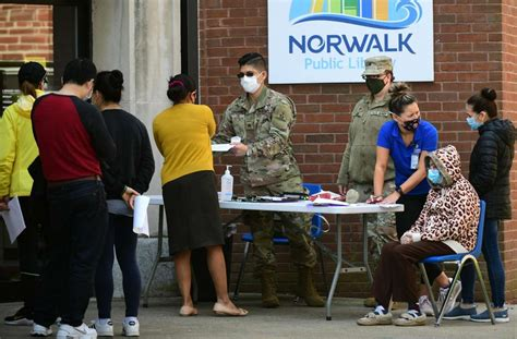 Photos: Mobile clinic brings more COVID-19 vaccines to Norwalk