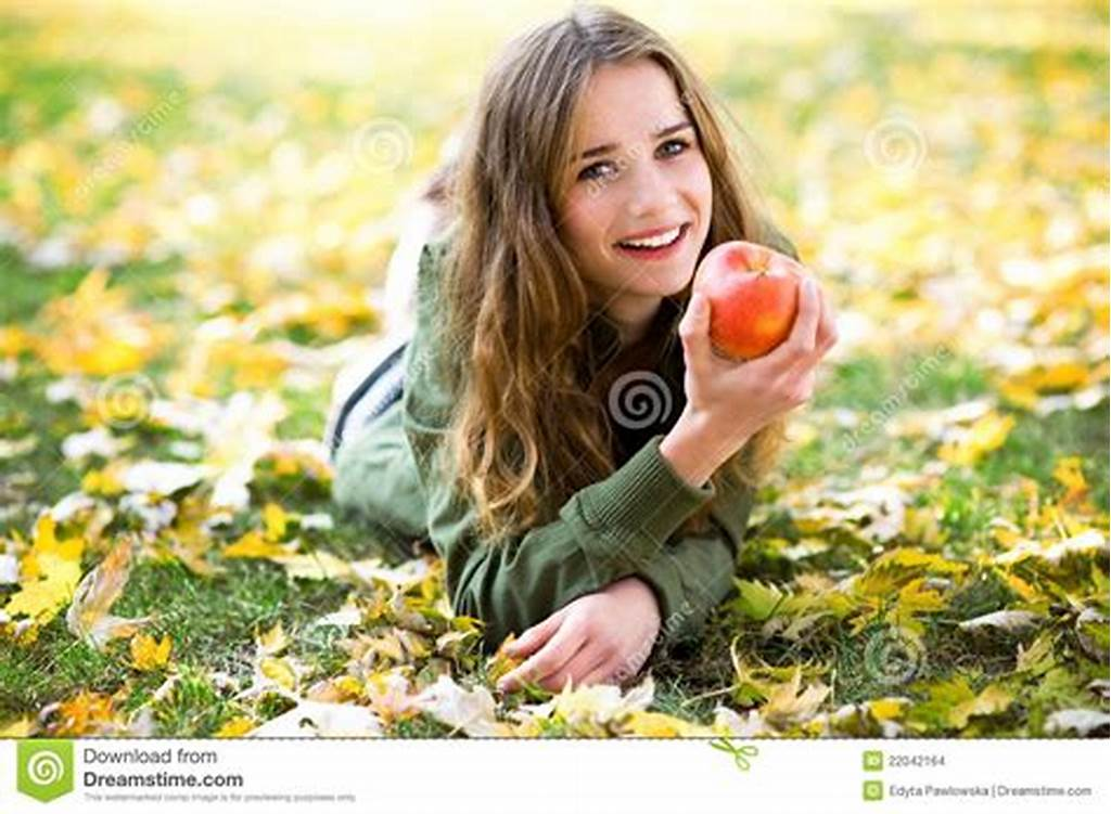 #Woman #Eating #Apple #Outdoors #In #Autumn #Stock #Images