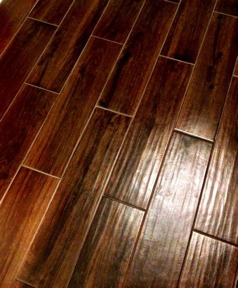 lowes wood like tile style selections 6 in x 24 in serso mahogany glazed porcelain floor tile lowe s flooring