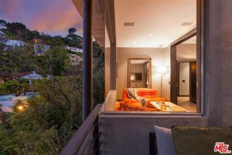 adam lambert relists striking modern home  la
