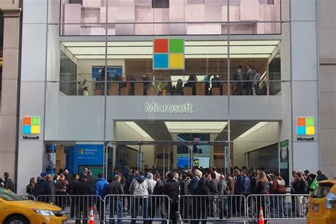 microsoft takes on apple with new store and surface book