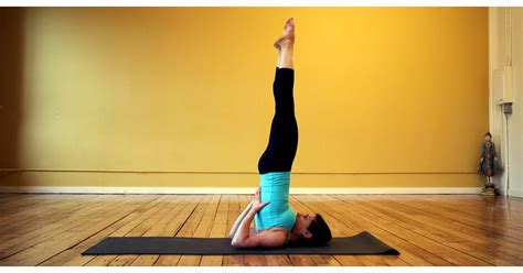 strike  yoga pose shoulderstand popsugar fitness