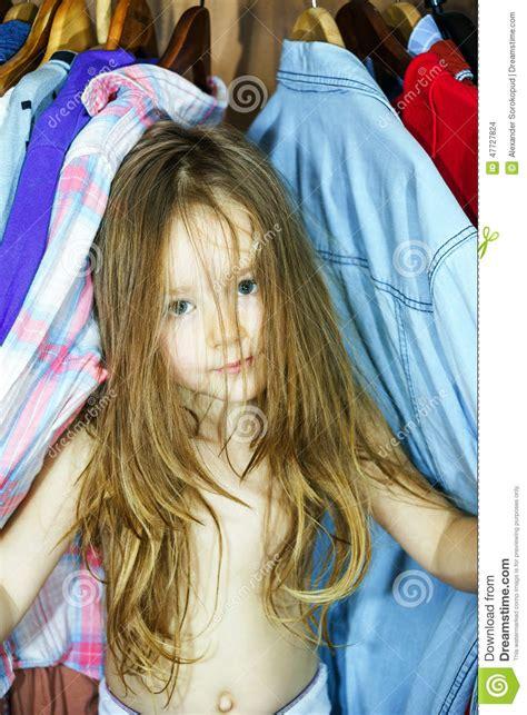 cute  girl hiding  wardrobe   parents