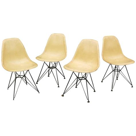 set of four eames for herman miller fiberglass side chairs