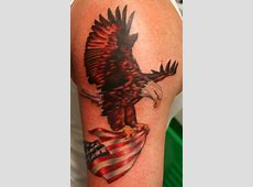 Eagle Flying With American Flag In Claws Tattoo On Shoulder