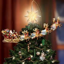 the thomas kinkade revolving christmas tree topper hammacher schlemmer