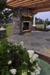 Stone Patio with Pergola and Fireplace