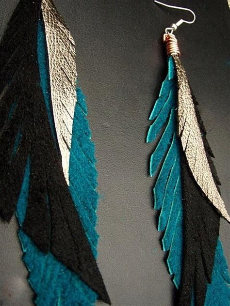 items similar  leather feather earrings black teal