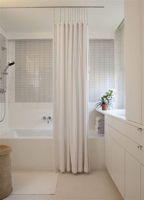 curtain hung from the ceiling bathroom