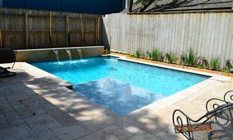geometric swimming pool  tanning ledge bubblers