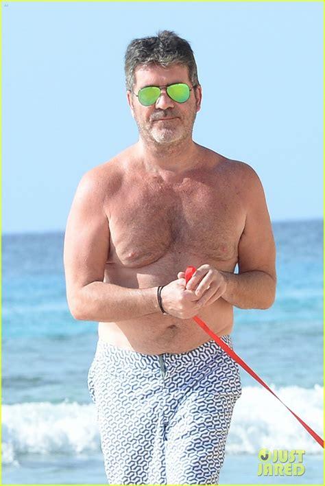 shirtless simon cowell soaks   sun  barbados photo