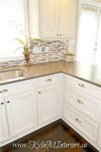 removing kitchen tile backsplash oak kitchen remodel painted cabinets and quartz