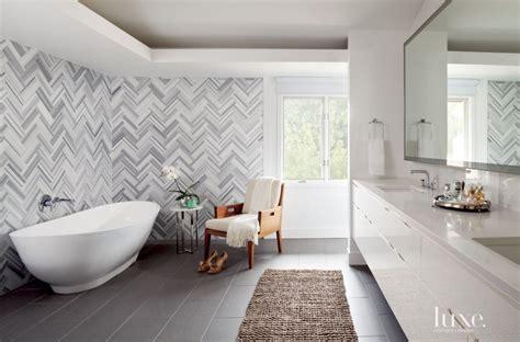 modern white bathroom  herringbone wall tiles luxe