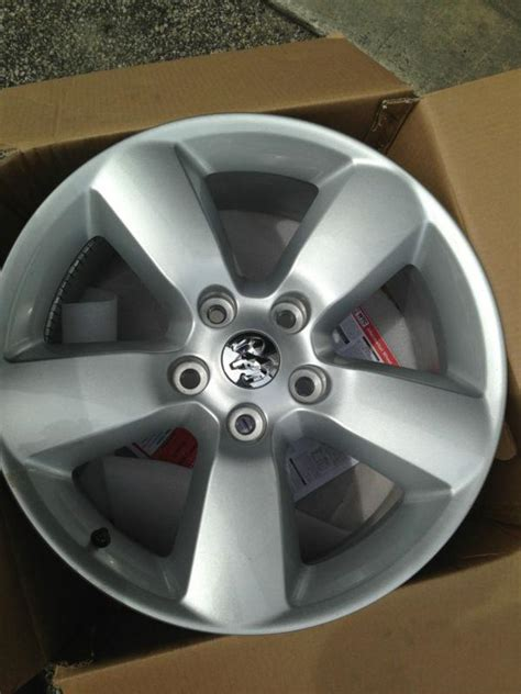 buy  dodge ram    painted oem alloy wheels