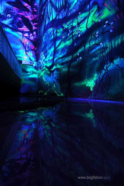 artist paints rooms with murals that glow under blacklight