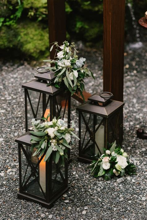 Lantern wedding decor Flowers on the ceremony lanterns