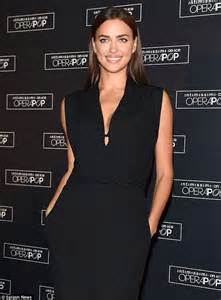 Shiny Black Tv Stand by Stunning Model Irina Shayk Displays A Hint Of Cleavage In