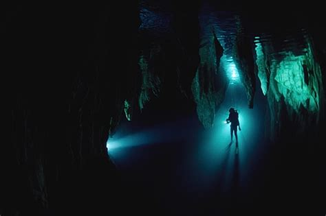 head diving chandelier cave   world turns