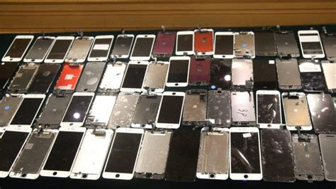 hong kong customs officials raid yields counterfeit iphone