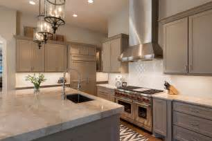 counter height kitchen island dining table beige cabinets kitchen transitional with beige kitchen