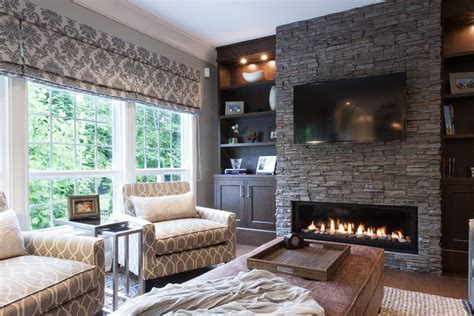 stacked fireplace with wood mantle family room