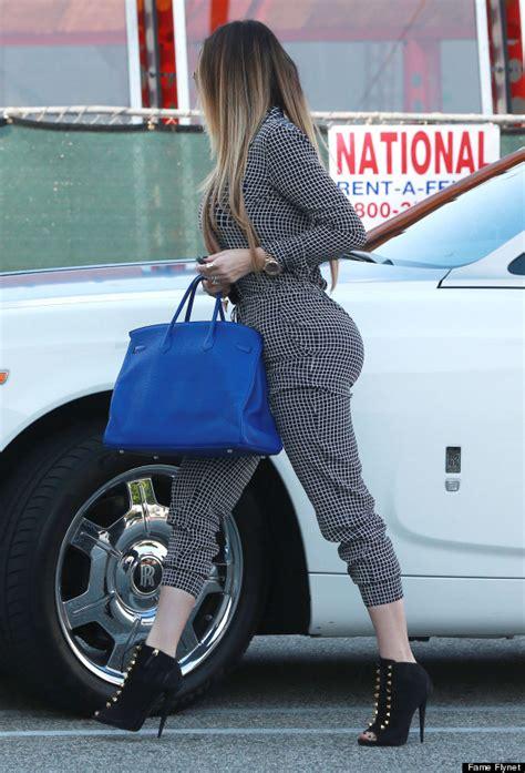 khloe kardashian steps   curve hugging jumpsuit
