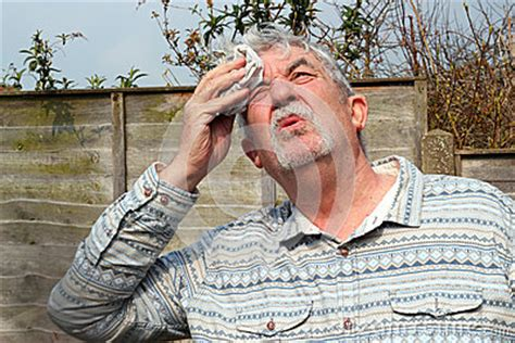 senior man hot  sweating stock photo image
