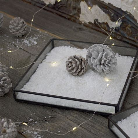 decorative snow by the little house shop