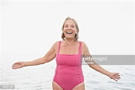 senior woman swimsuit stock   pictures getty images