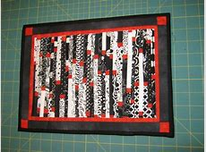 Black, white and orange jelly roll quilt