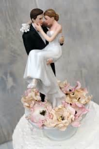 wedding cake tops bed of roses groom holding the wedding cake topper wedding collectibles