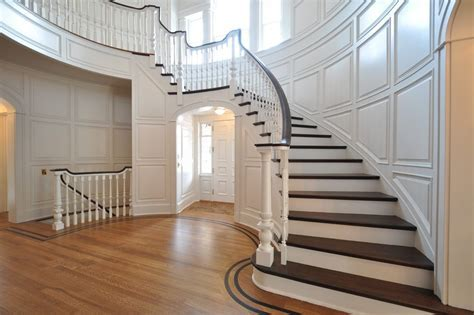 arched staircase traditional with white wainscoting farm