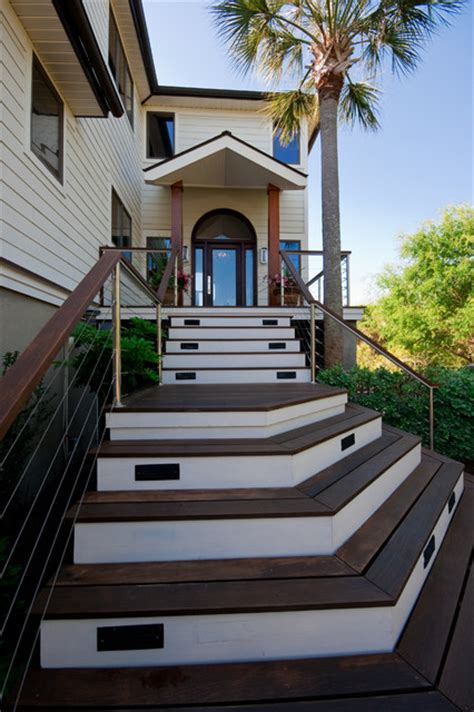 modern island home front stair tropical exterior