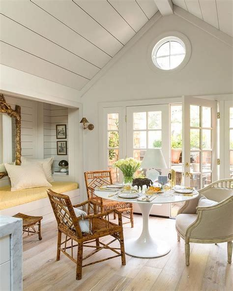 chic dining room features  shiplap vaulted ceiling