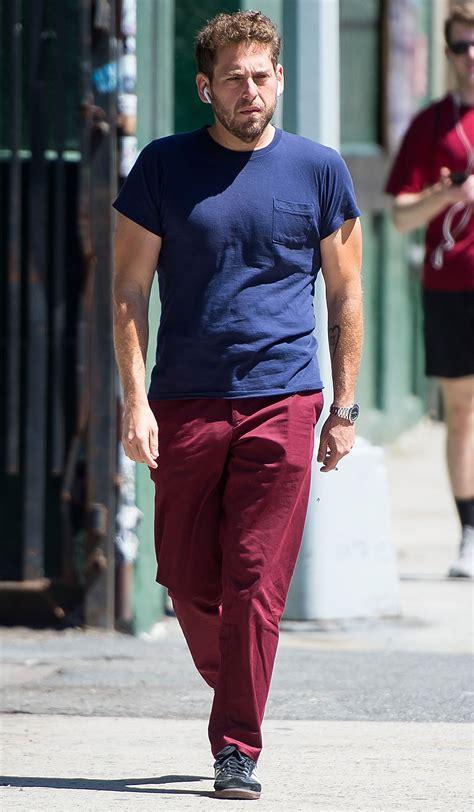 jonah hill walks  nyc  muscle baring  shirt