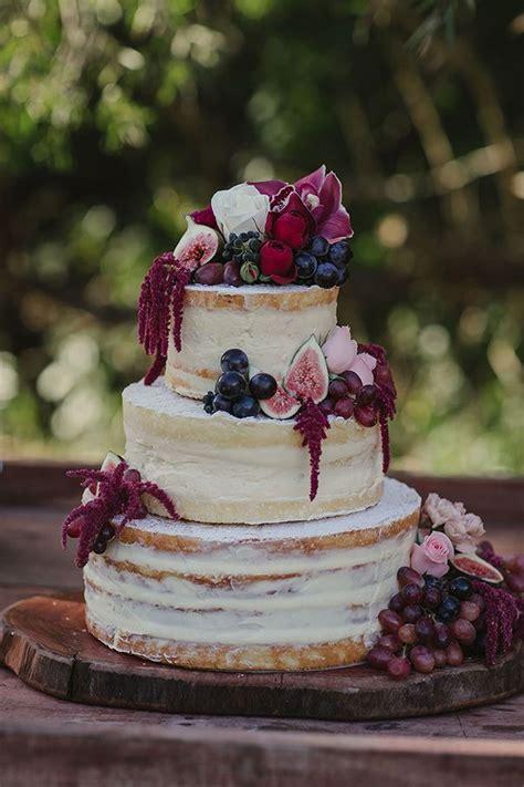 semi naked wedding cake burgundy  white fresh fruit