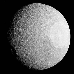 Cassini sees huge crater on Saturn's moon Tethys
