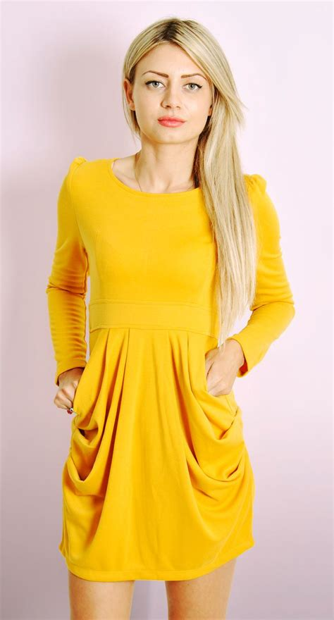 draped in draped dress with sleeves