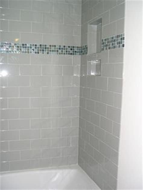 4x16 subway tiled master shower with accent design